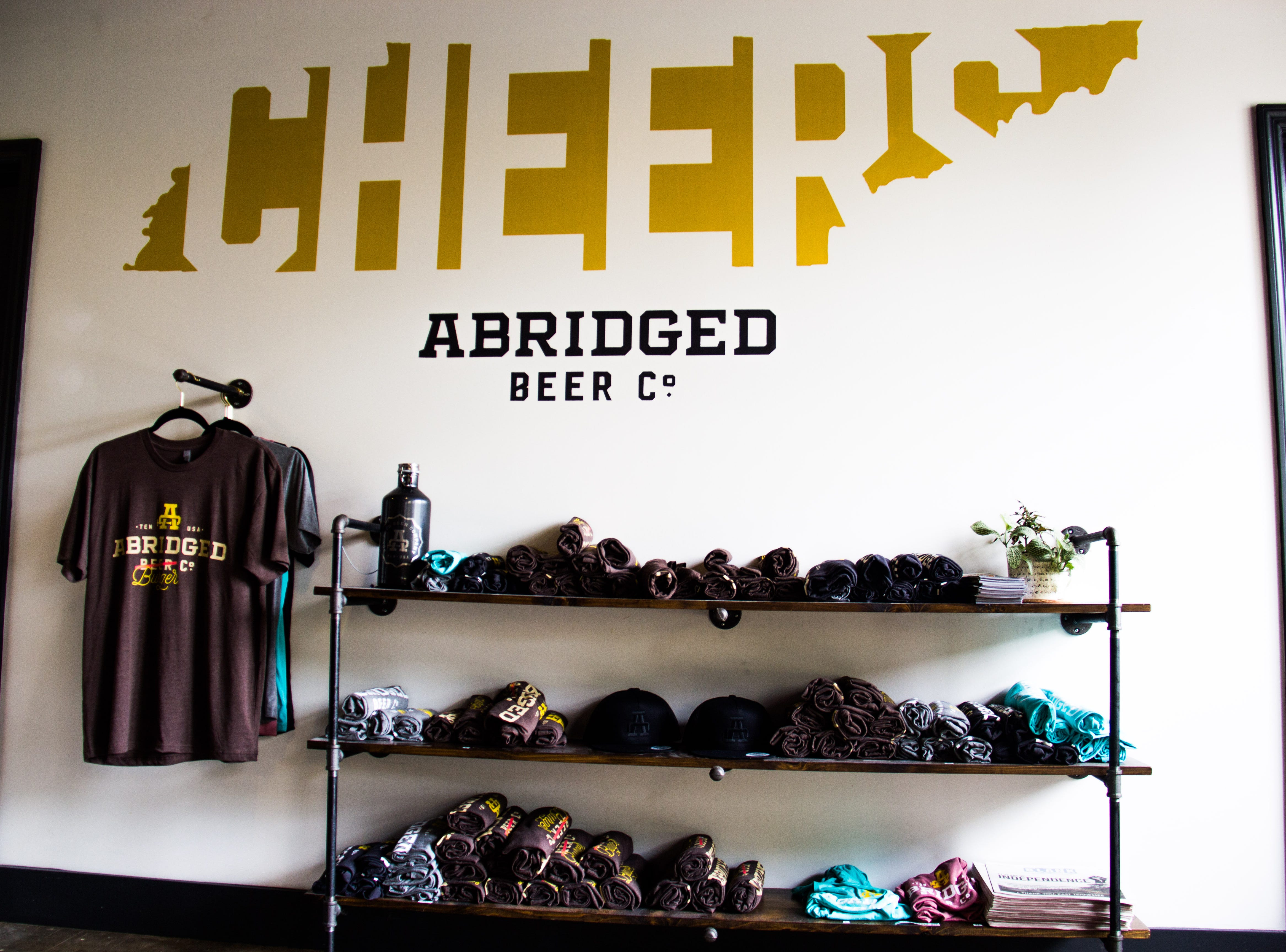 Shirts are displayed at Abridged Beer Co. on Oct. 10, 2018. A new sour beer facility being opened by Abridged in spring 2019  will have retail space and a bar.