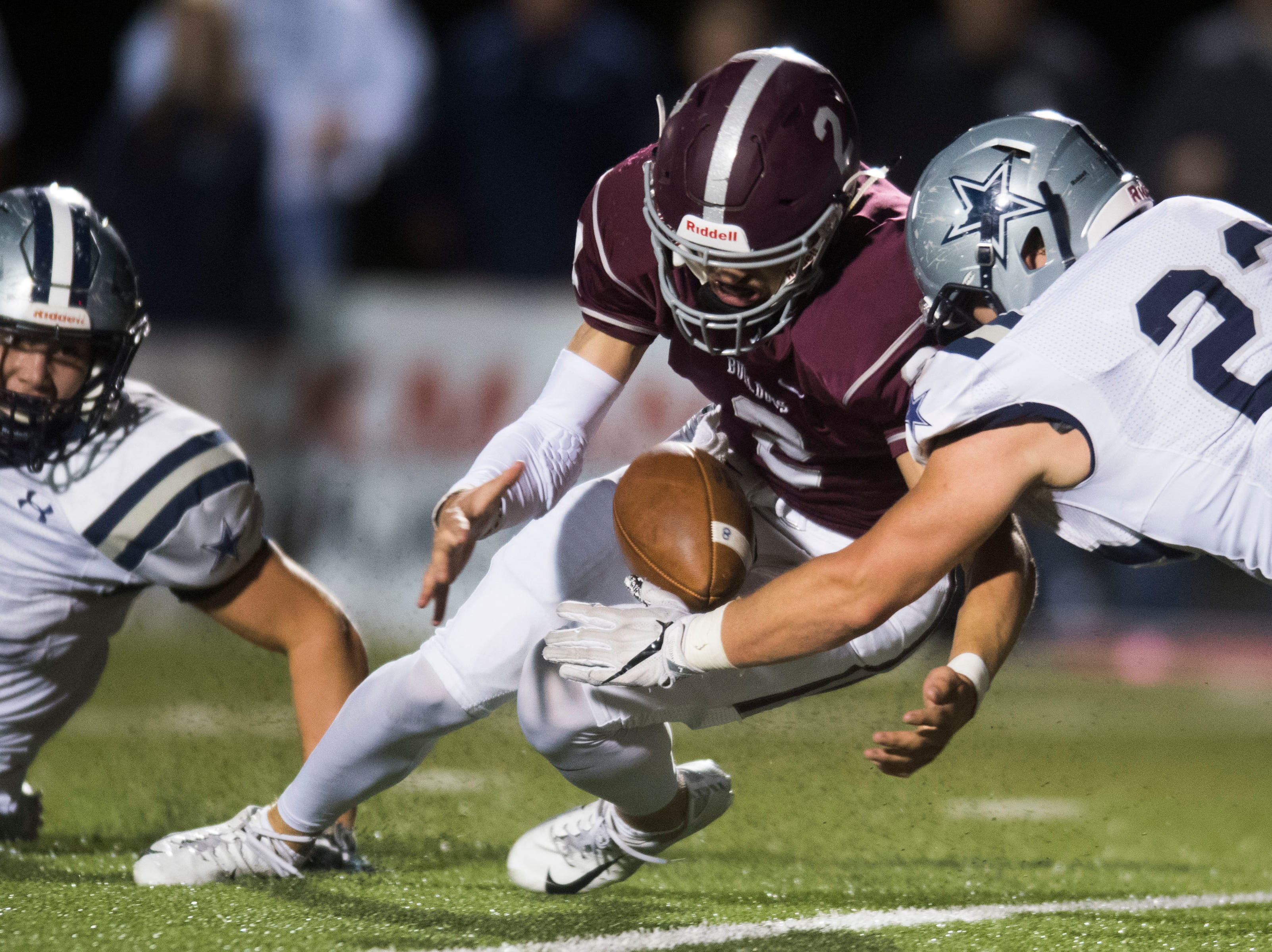 Players dive for a fumbled ball during a game between Bearden and Farragut at Bearden Thursday, Oct. 11, 2018. Bearden took down Farragut 17-13.