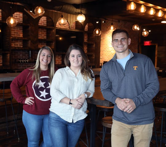 Shannon Conklin, Chloe Broussard and co-owner Ben Austin of Stock & Barrel are photographed at their Nashville location Thursday, Oct. 11, 2018. Conklin will be manager of the front of the house, and Broussard will be a bartender.