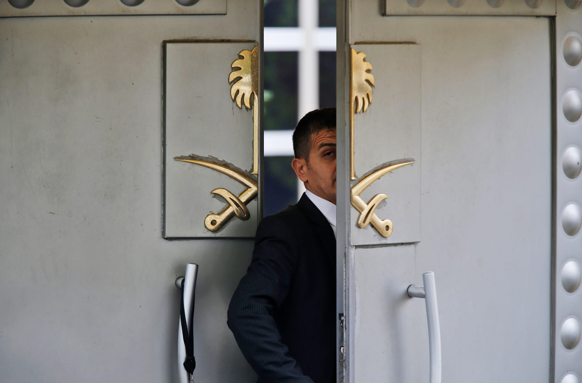 A security guard walks in the Saudi Arabia consulate in Istanbul, Tuesday, Oct. 9, 2018. Turkey said Tuesday it will search the Saudi Consulate in Istanbul as part of an investigation into the disappearance of Jamal Khashoggi, a missing Saudi contributor to The Washington Post, a week after he vanished during a visit there. (AP Photo/Lefteris Pitarakis)