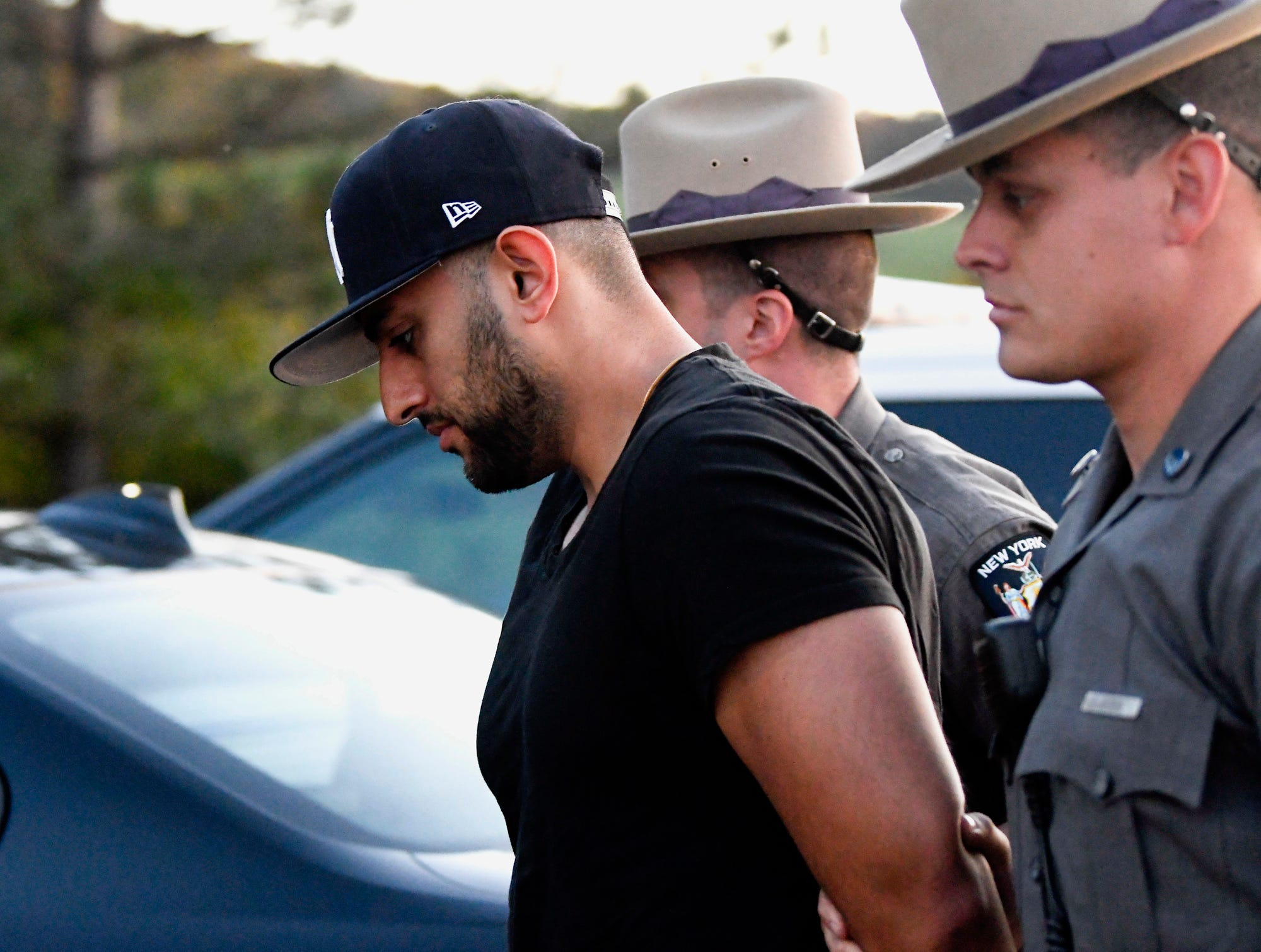Nauman Hussain is brought into Cobleskill Town, N.Y., court for arraignment Wednesday, Oct. 10, 2018. Limousine service operator, Hussain, was charged Wednesday with criminally negligent homicide in a crash that killed 20 people, while police continued investigating what caused the wreck and whether anyone else will face charges. (AP Photo/Hans Pennink)