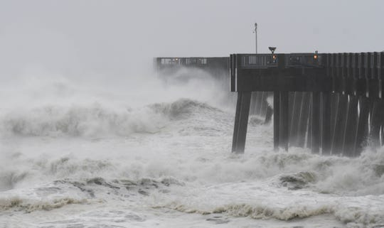Waves crash over the end of the Panama City Beach Pier as Hurricane Michael approaches. Mandatory Credit: Craig Bailey/FLORIDA TODAY via USA TODAY NETWORK
