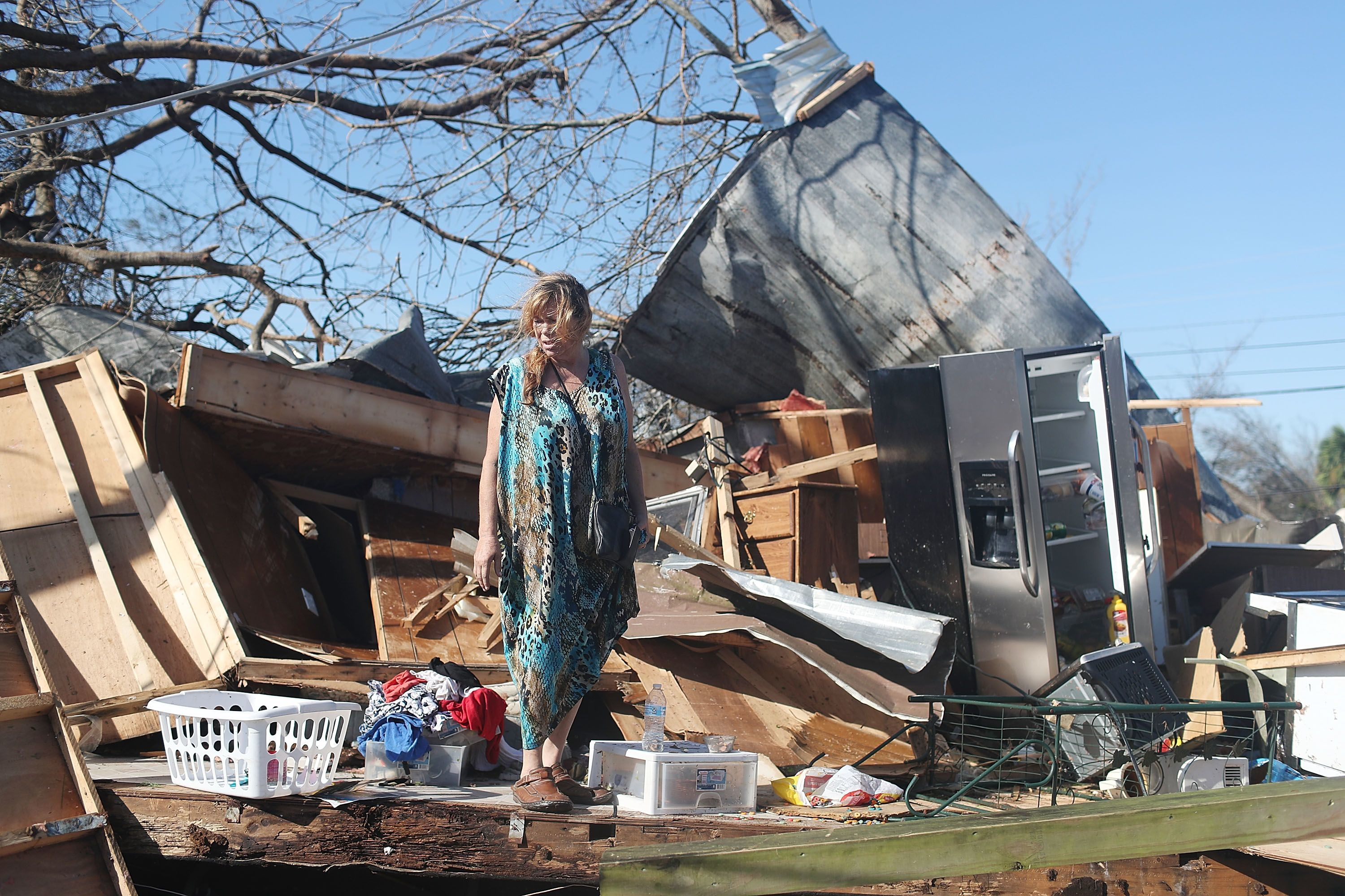 Kathy Coy stands among what is left of her home after Hurricane Michael destroyed it on October 11, 2018 in Panama City, Florida.