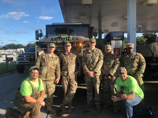 John Billiot and Ronnie Cormier of America's Cajun Navy with members of the Florida National Guard