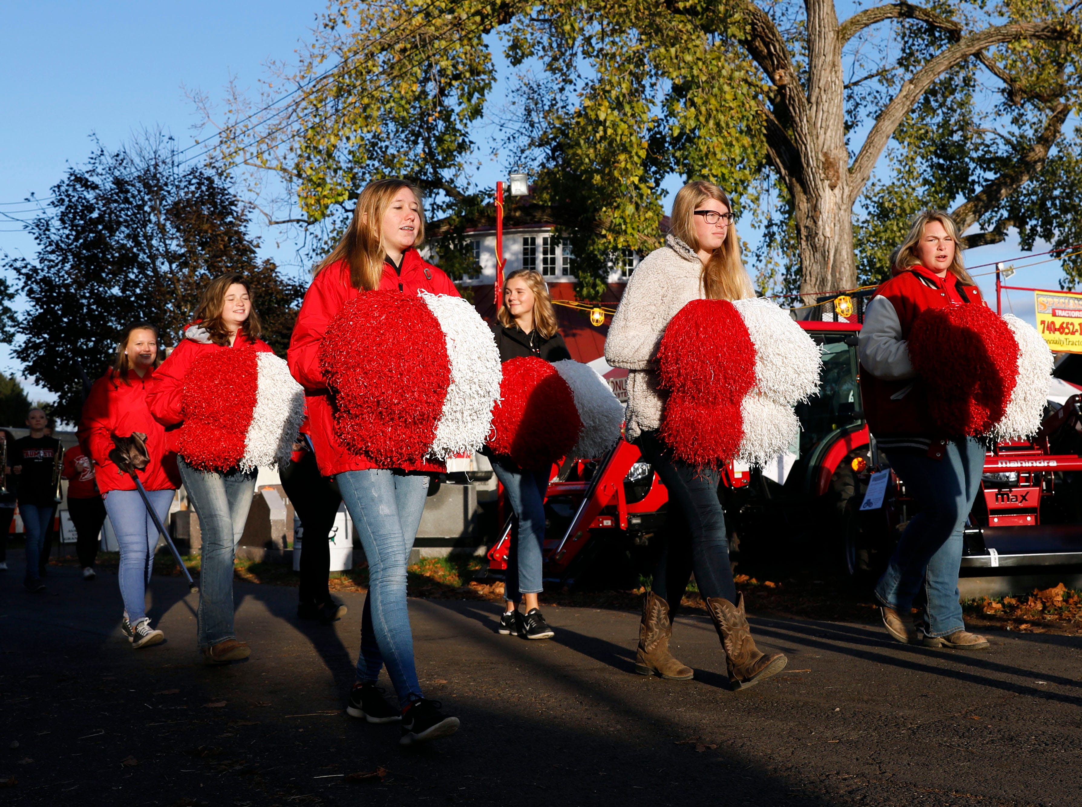 The Fairfield Union High School marching band parade around the Fairfield County Fairgrounds before performing the national anthem prior to the livestock auction Friday morning, Oct. 12, 2018, at the Fairfield County Fair in Lancaster.