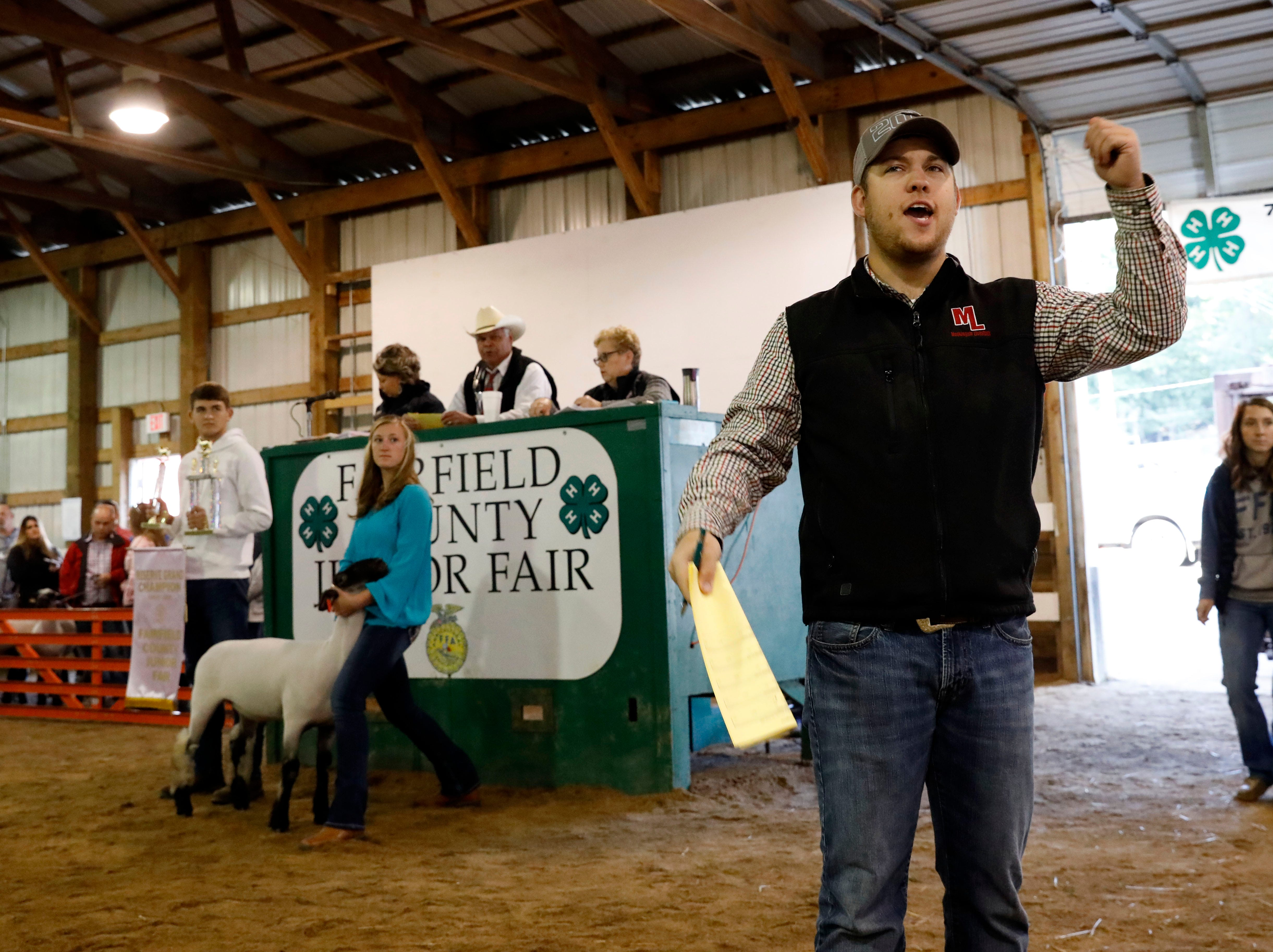 The Fairfield County Fair Junior Fair livestock auction continued Friday morning, Oct. 12, 2018, at Feeder Creek Show Arena on the fairgrounds in Lancaster.