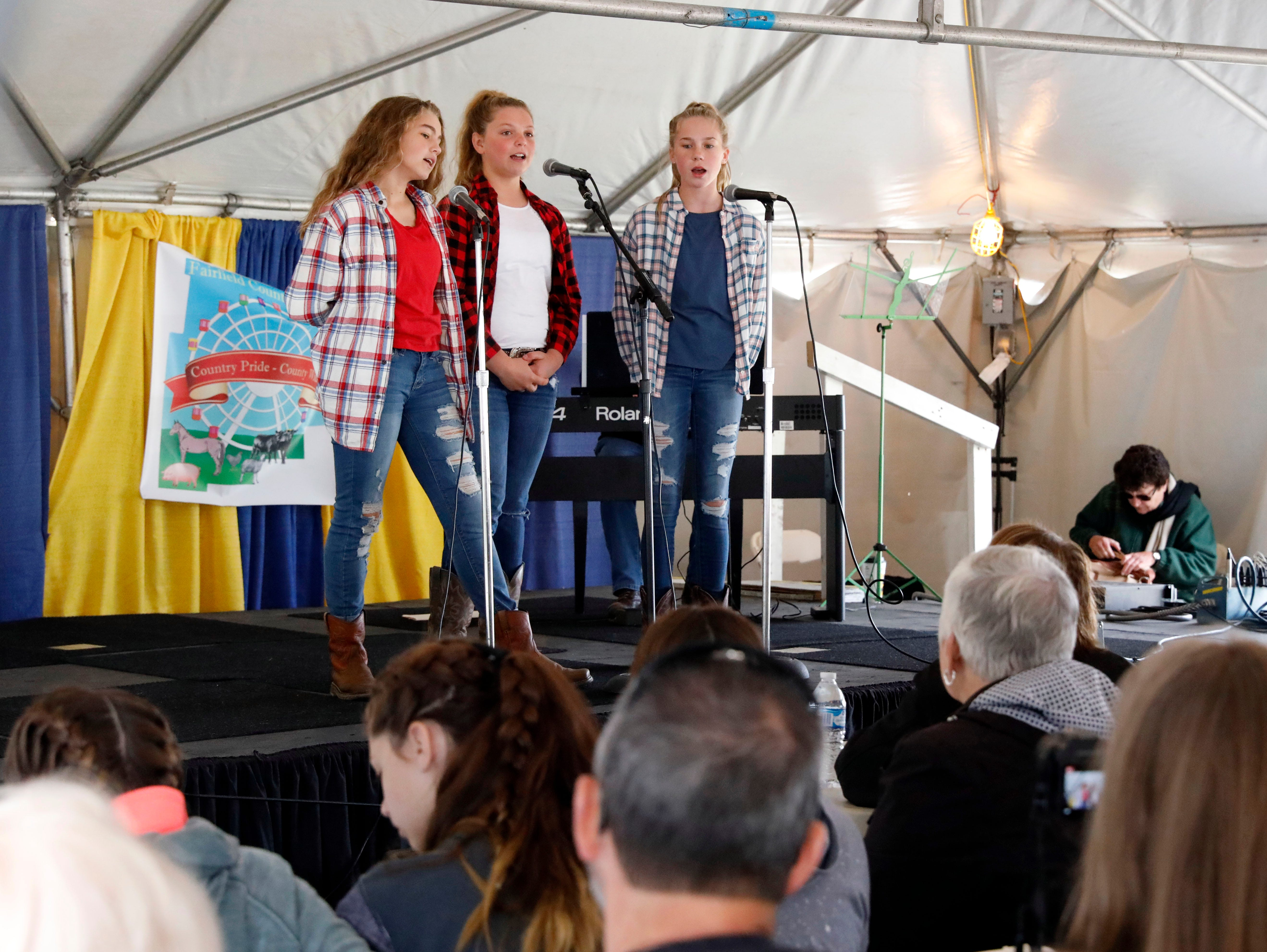 Ella Kimball, left, Jenna Brown, center and Brooklynn Roshon sing during the Rising Stars contest Friday morning, Oct. 12, 2018, at the Fairfield County Fair in Lancaster. The trio are seventh graders at Rushville Middle School.