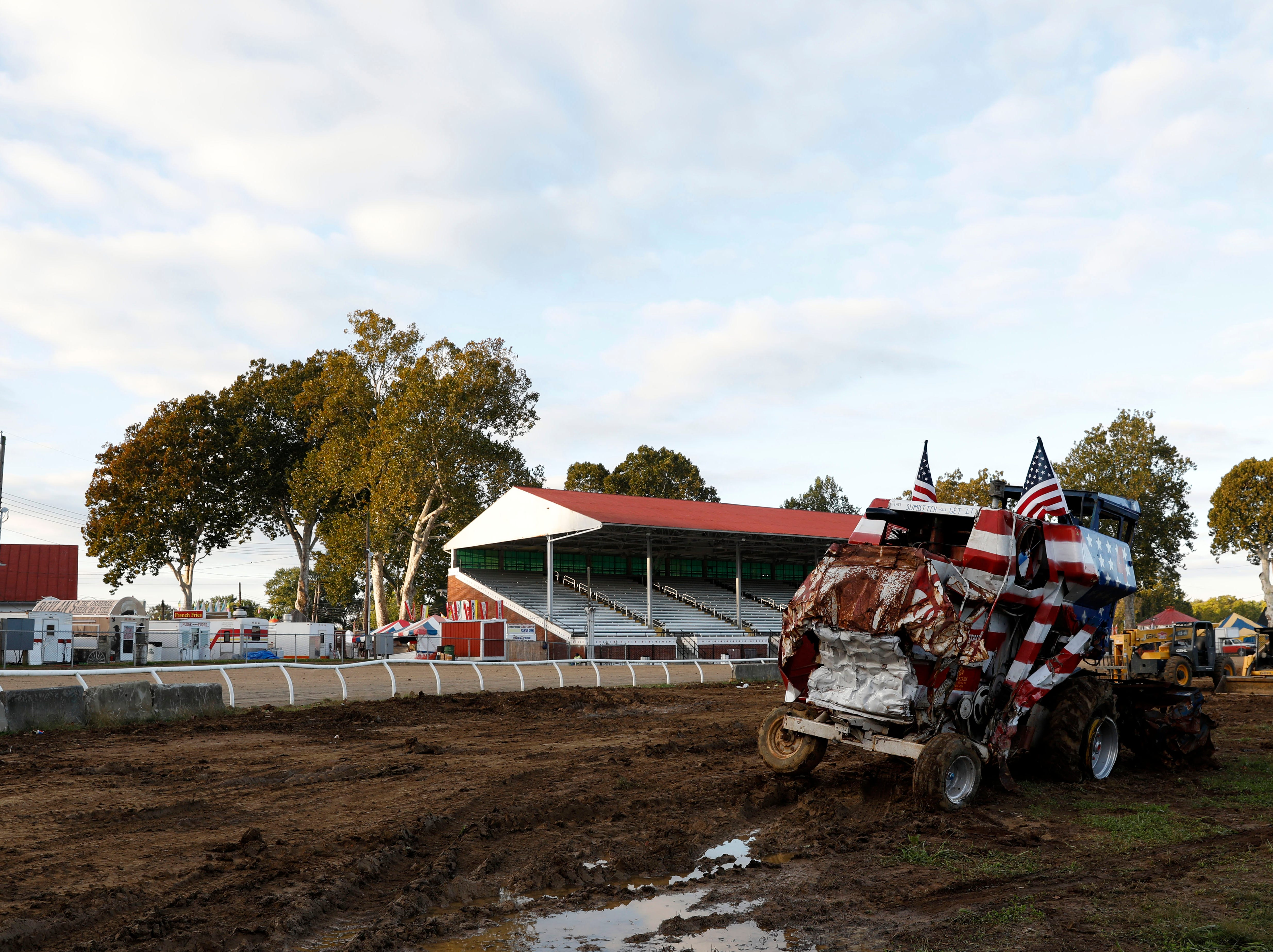 A combine that participated in Thursday night's combine demolition derby sits on the track at the Fairfield County Fairgrounds Friday morning, Oct. 12, 2018, in Lancaster.