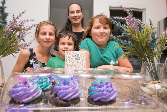 Kristine Golsch, left, is the birthday girl the decorated cupcakes mom Jennifer picked up for to celebrated her 10th birthday, but Jennifer got the bigger surprise when she arrived at Kroger to get the cupcakes to discover they'd been paid for by an anonymous well-wisher. With Kristine and Jennifer Friday, Oct. 12, 2018 are Kristine's siblings 4-year-old Michael and 8-year-old Sarah.