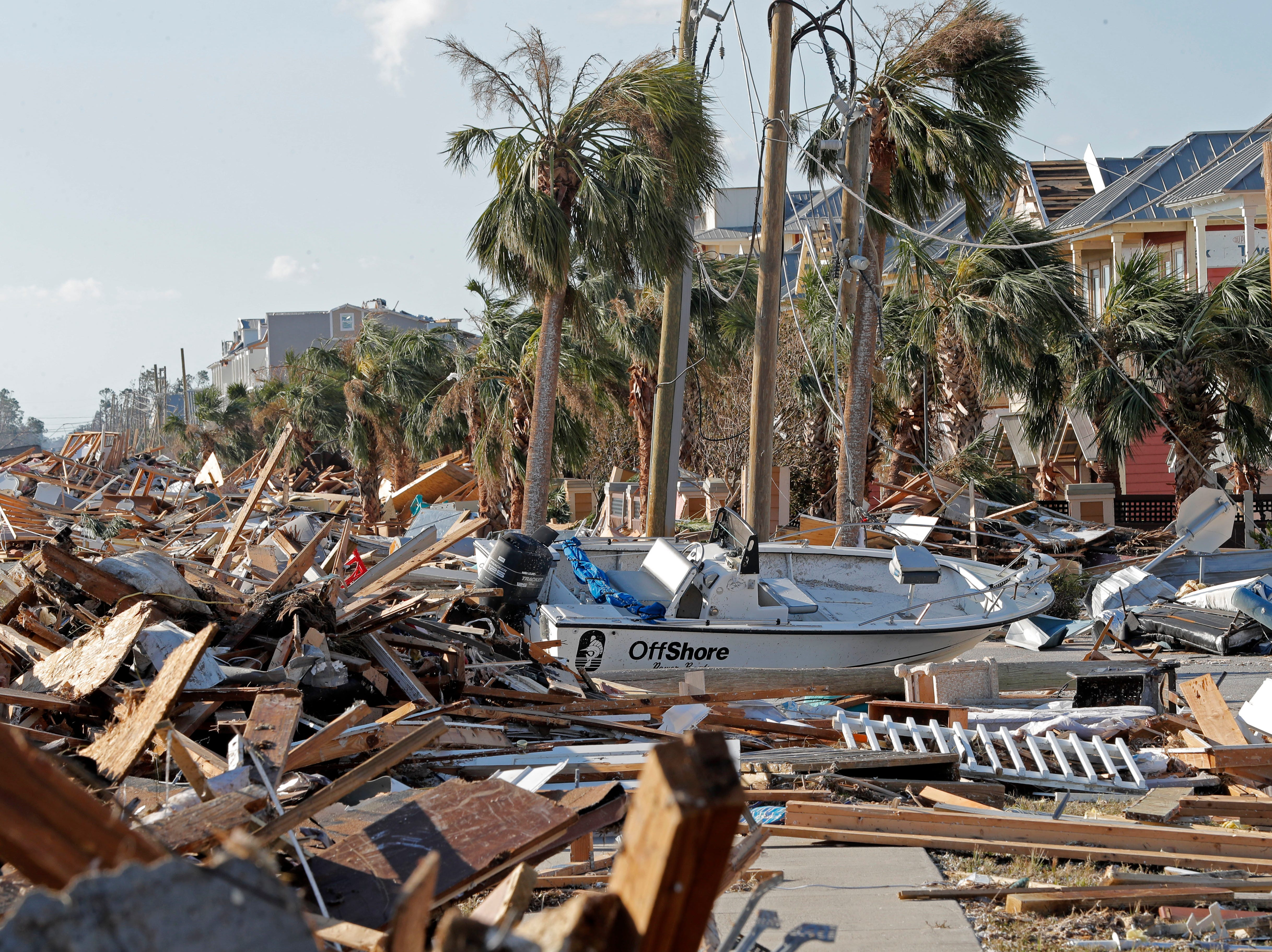 Destruction is seen in the aftermath of Hurricane Michael in Mexico Beach, Fla., Thursday, Oct. 11, 2018. The devastation inflicted by Hurricane Michael came into focus Thursday with rows upon rows of homes found smashed to pieces, and rescue crews began making their way into the stricken areas in hopes of accounting for hundreds of people who may have stayed behind. (AP Photo/Gerald Herbert)