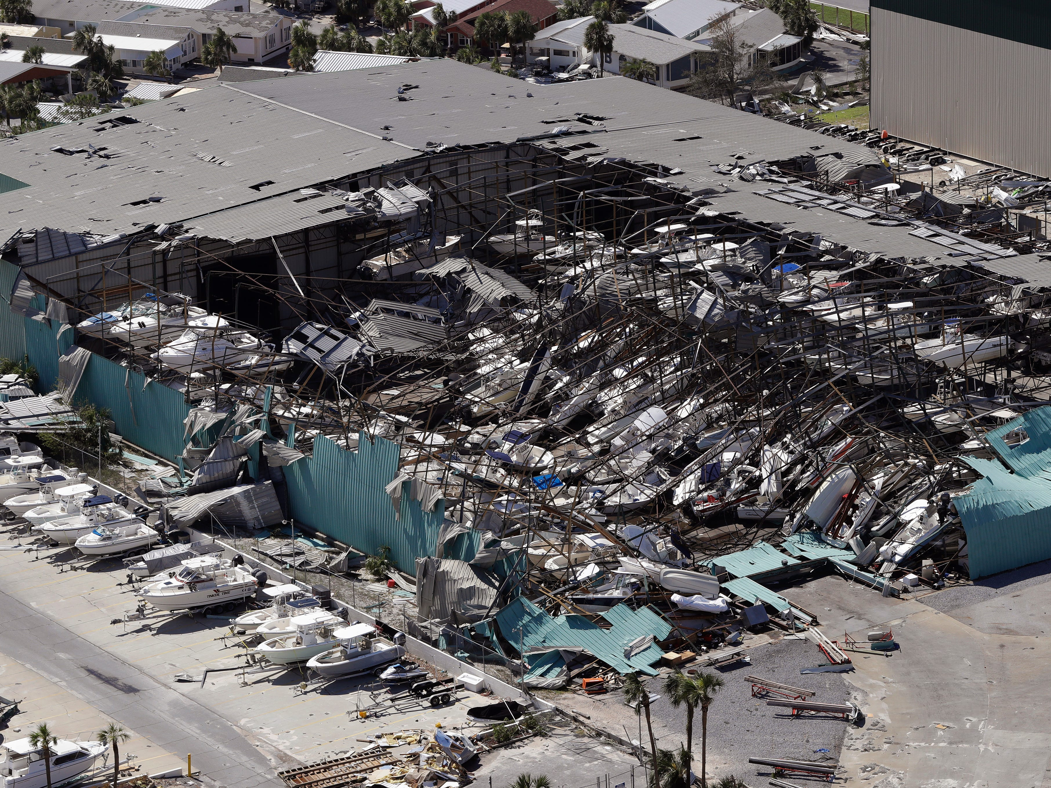 A roof over a boat storage building is collapsed following Hurricane Michael Thursday, Oct. 11, 2018, in Panama City Beach, Fla. Hurricane Michael made landfall Wednesday as a Category 4 hurricane with 155 mph (250 kph) winds and a storm surge of 9 feet (2.7 meters). (AP Photo/Chris O'Meara)
