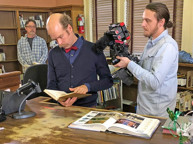 """Musician and actor Will Oldham (center) appears in """"Our Library"""" a new documentary about Louisville's public library system airing on KET in October."""