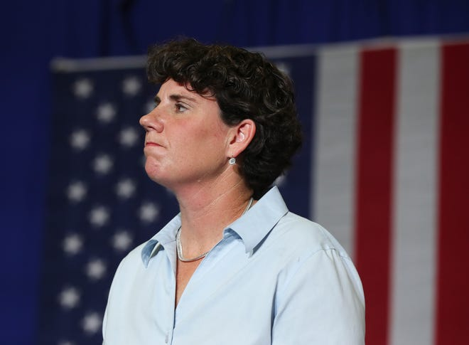 Congressional candidate Amy McGrath listened as former Vice President Joe Biden gave a speech during their event at the Bath County High School.
