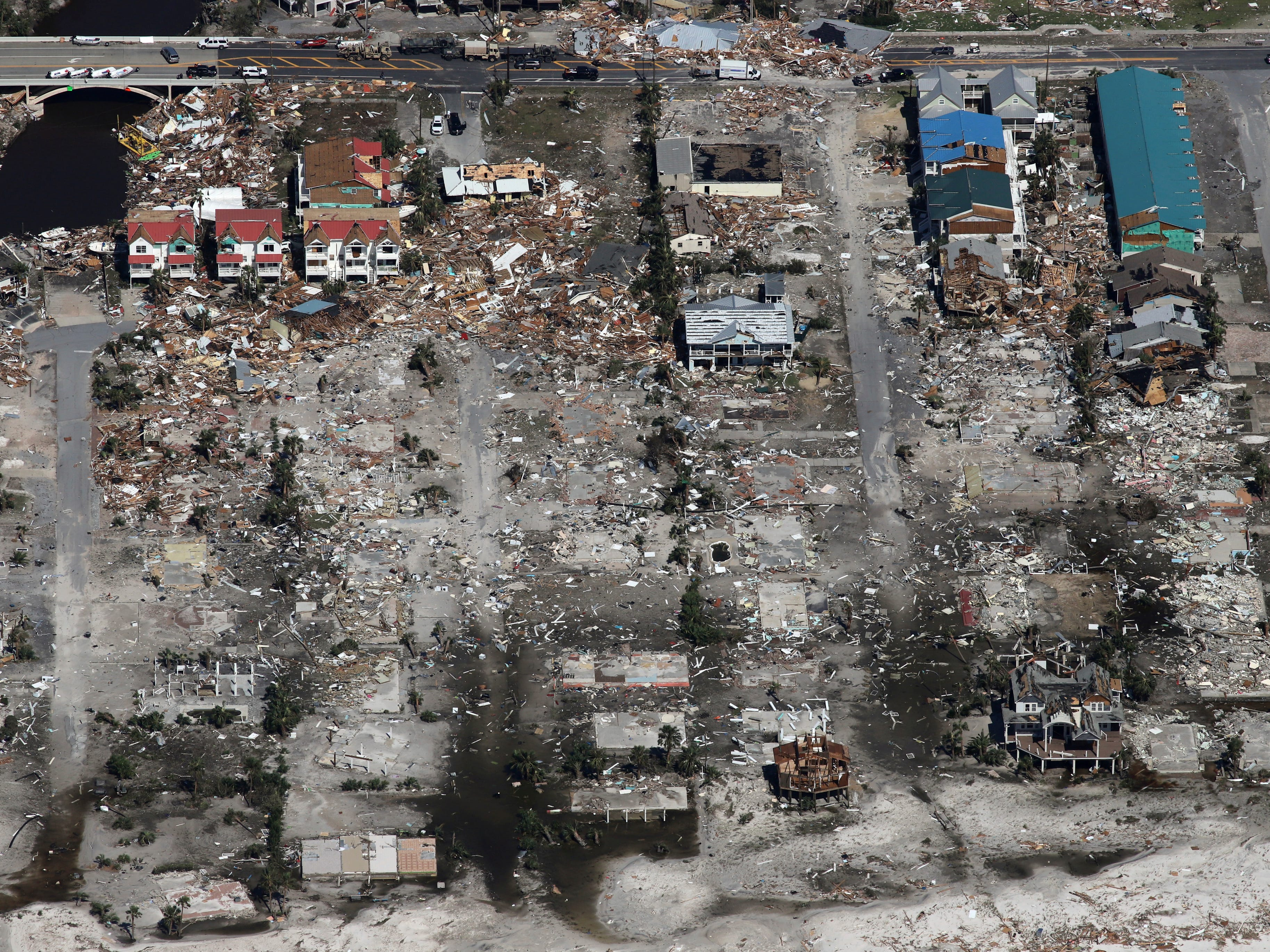 An entire neighborhood between 40th Street and 42nd Street in Mexico Beach, Fla. was wiped out by Hurricane Michael, Thursday, Oct. 11, 2018. The devastation inflicted by Hurricane Michael came into focus Thursday with rows upon rows of homes found smashed to pieces, and rescue crews began making their way into the stricken areas in hopes of accounting for hundreds of people who may have stayed behind. (Michael Snyder/Northwest Florida Daily News via AP)