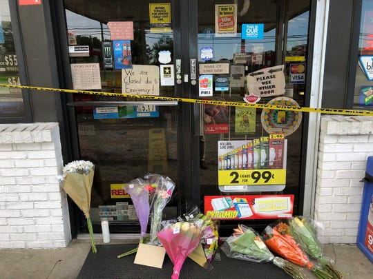 Flowers and cards were left outside of the entrance to the Stop-N-Go gas station, 2402 Allison Ln., Jeffersonville, on Oct. 12, 2018. A store clerk was shot and killed at the store on Oct. 11 during a robbery.