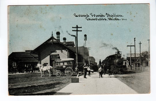 A photo taken around 1910 of Charlotte's Grand Trunk Western railroad passenger station shows a train, along with horse and carriages.