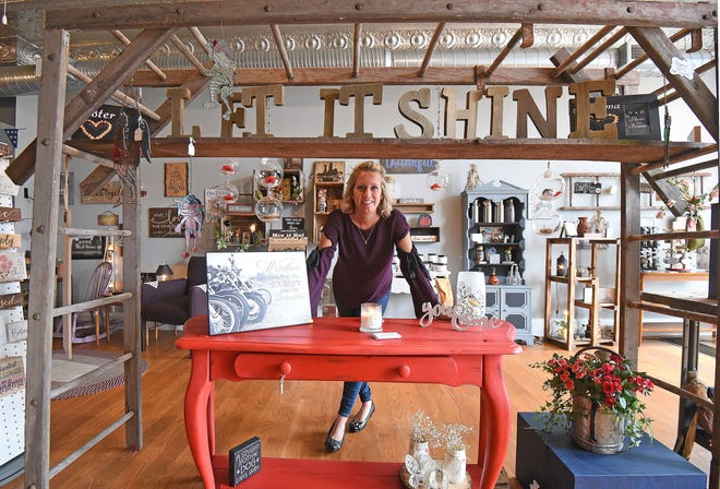 Melissa Lawrence stands in her new store, Let it Shine, at 31 Fourth St. on Thursday afternoon.
