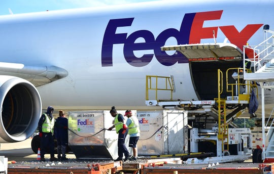 October 12, 2018 - FedEx material handlers offload containers at the Memphis hub. FedEx expects to add more than 55,000 positions throughout its network to help the holidays arrive this year, with 3,800 positions in Memphis. FedEx Express is hiring for 1,000 positions, and FedEx Ground is hiring for 2,800 positions. These local openings include permanent, part-time, seasonal package handlers and other support positions.