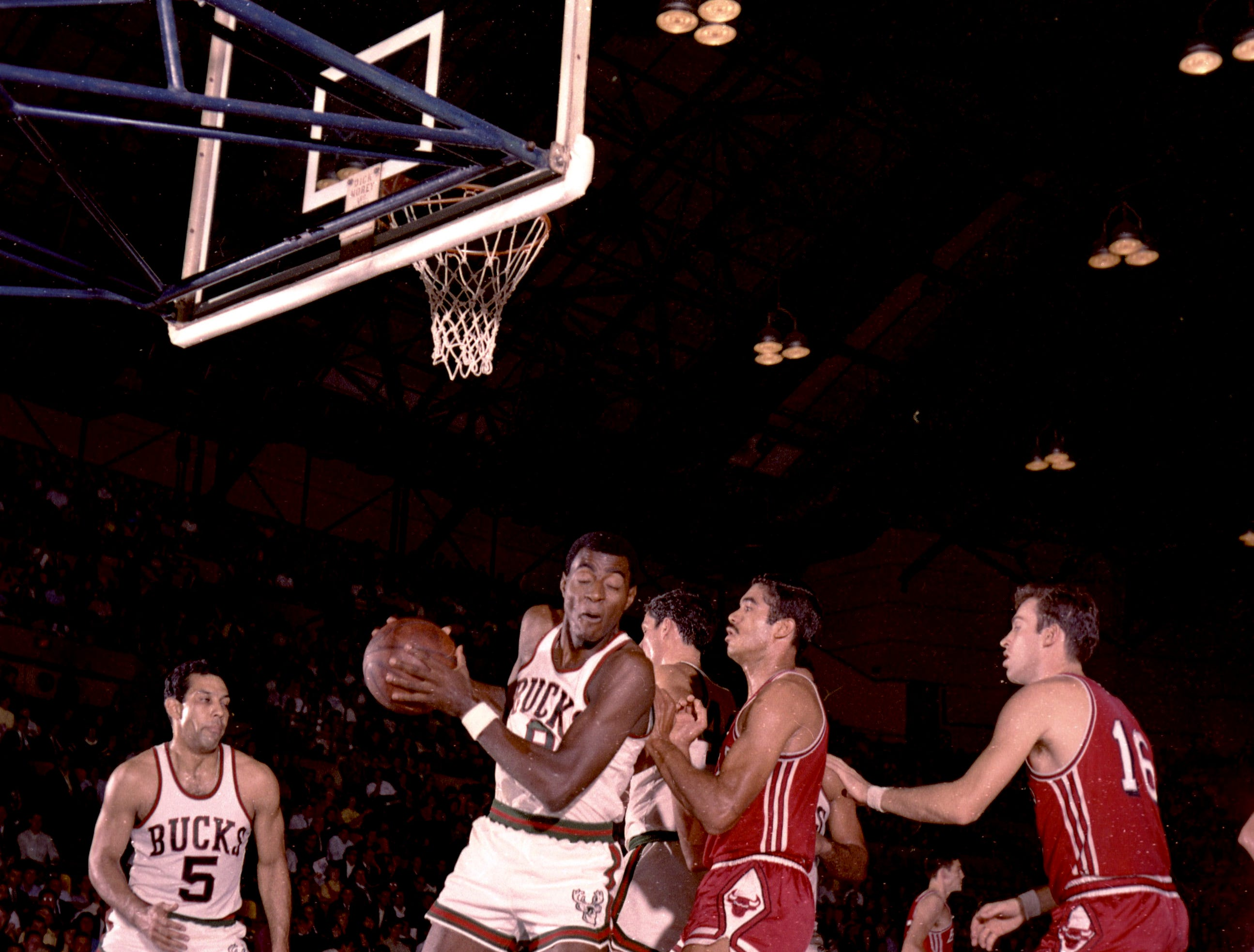 Milwaukee Bucks forward Bob Love (8) grabs a rebound while teammate Guy Rodgers (5) looks on during the first Milwaukee Bucks regular-season game at the Milwaukee Arena on Oct. 16, 1968. The Chicago Bulls defeated the Bucks, 89-84.