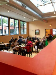 The dining room at the new location of Antigua Latin Inspired Kitchen, 6207 W. National Ave., takes advantage of the building's original skylight (visible at the upper right of the photo).