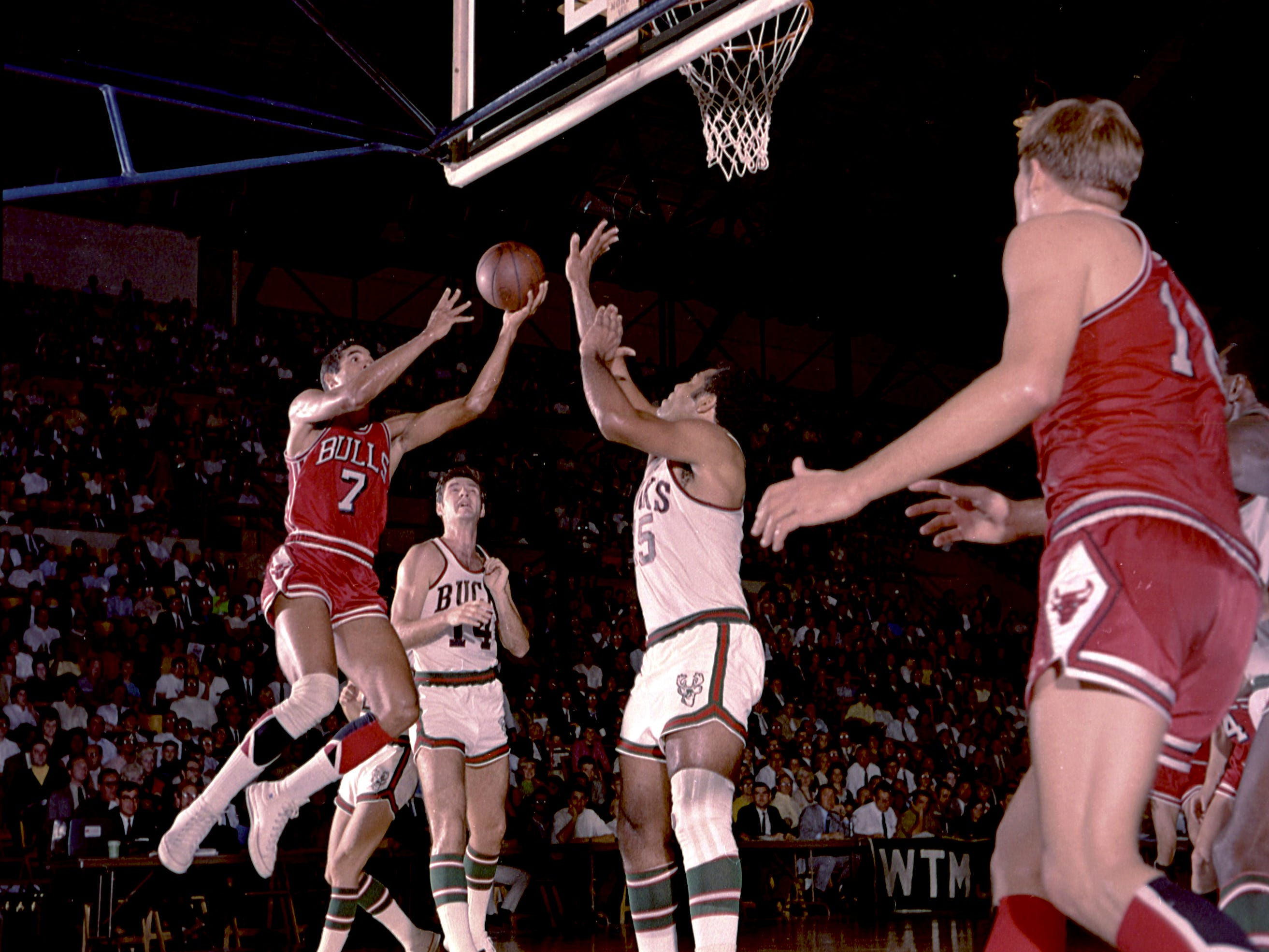 Milwaukee Bucks center Wayne Embry (15) goes up to block a shot by Chicago Bulls forward Jim Washington (7) during the Bucks' first-ever regular-season NBA game on Oct. 16, 1968, at the Milwaukee Arena.