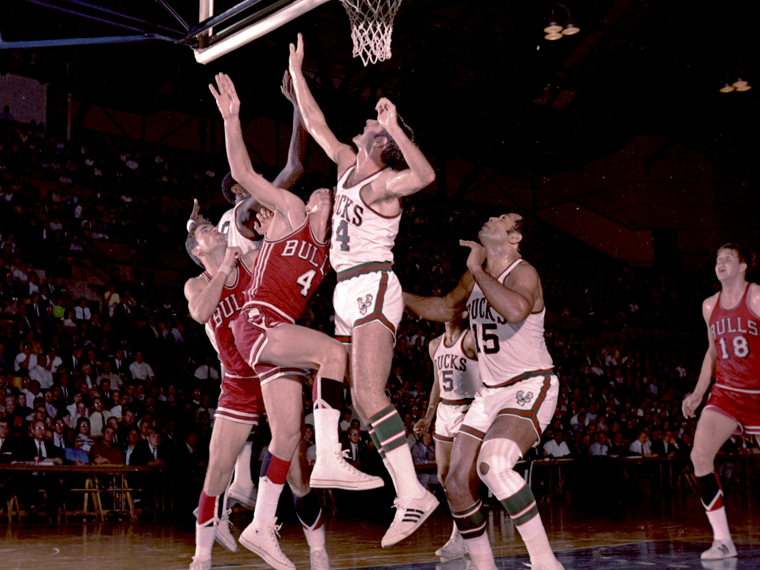 Milwaukee Bucks guard Jon McGlocklin goes up for a rebound during the Bucks' inaugural game in the NBA on Oct. 16, 1968, against the Chicago Bulls at the Milwaukee Arena. The Bucks lost, 89-84.