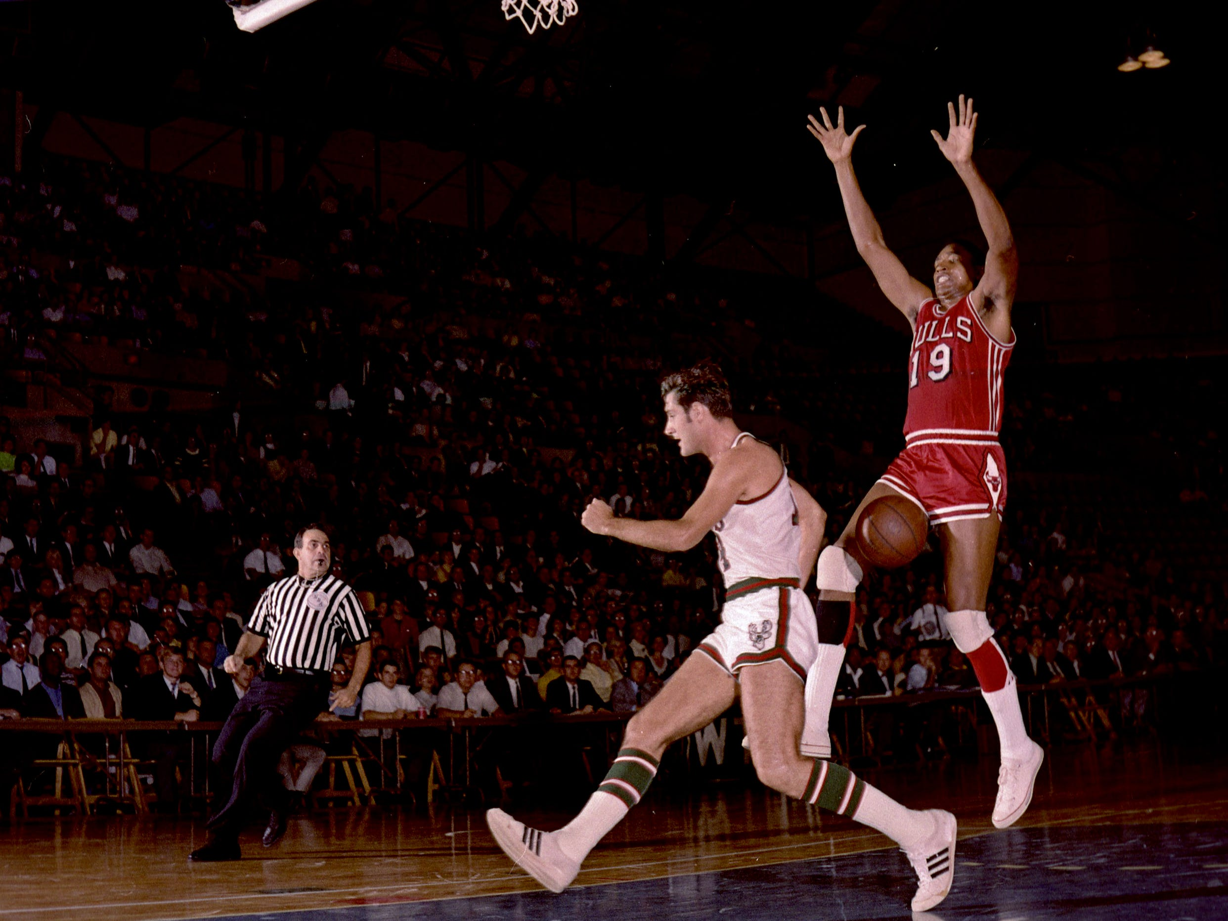 Milwaukee Bucks guard Jon McGlocklin strips the ball from Chicago Bulls forward Bob Boozer during the Bucks' first-ever regular-season NBA game on Oct. 16, 1968, at the Milwaukee Arena. The Bucks lost, 89-84 .