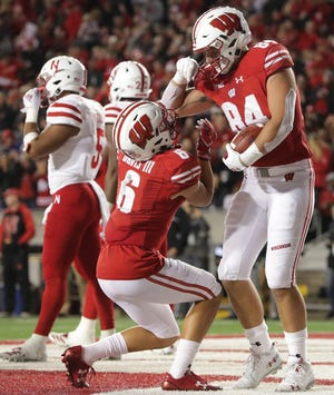 Wisconsin tight end Jake Ferguson (right) has 16 catches this season, including two touchdowns.