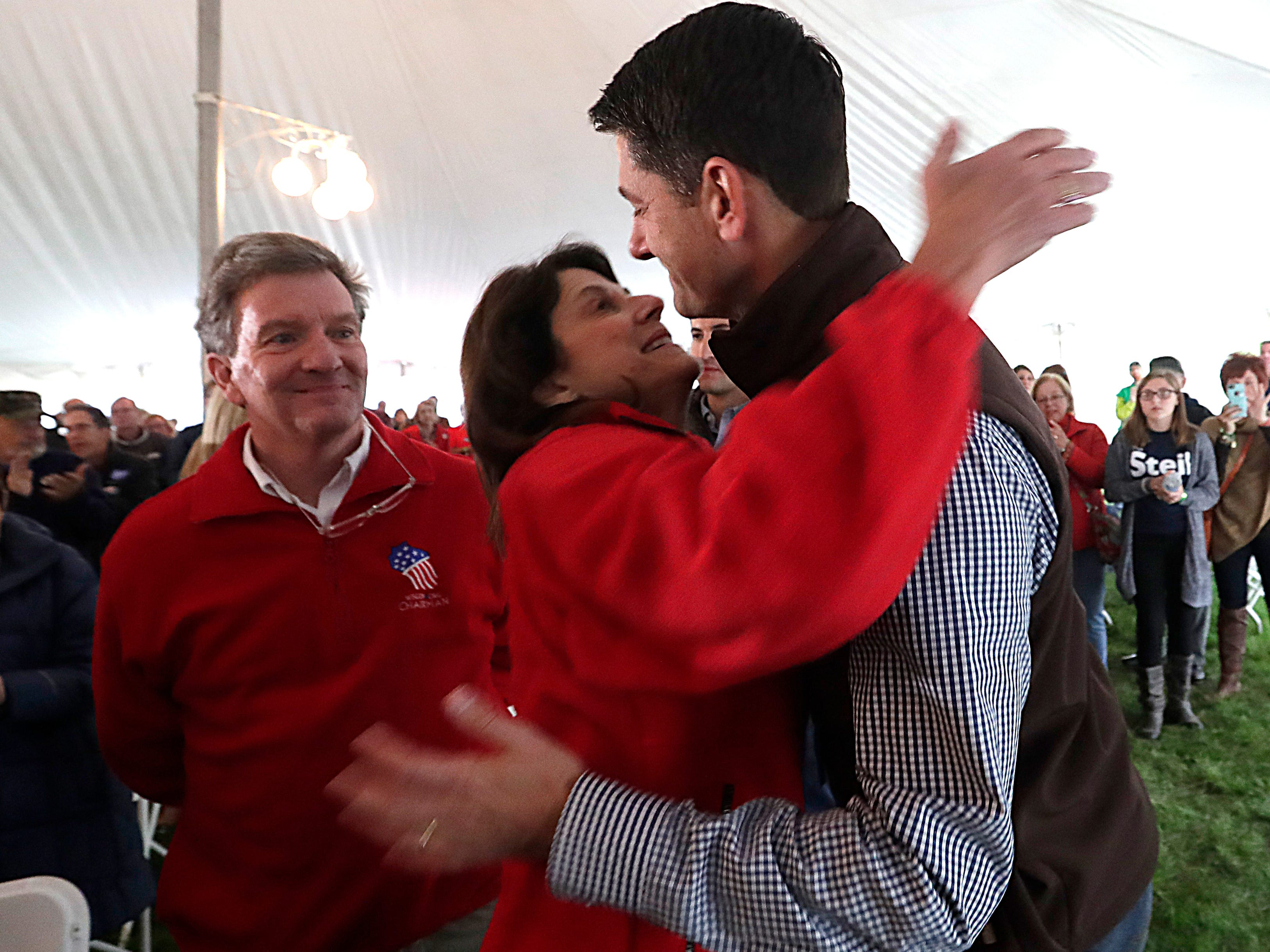 "Wisconsin First District Congressman and House Speaker Paul Ryan is greeted warmly by U.S. Senate candidate Leah Vukmir and Brad Courtney, chairman of the Wisconsin Republican Party, during  ""Fall Fest"" Sept. 29 in Burlington."
