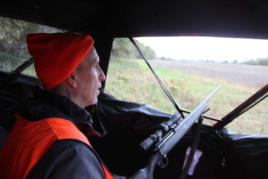 Bill Waldron of Greendale looks out from a ground blind during a Learn To Hunt program.