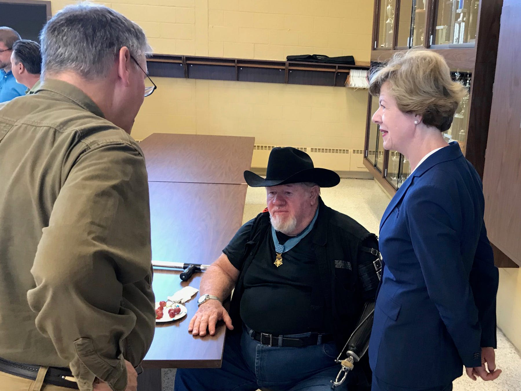 "Medal of Honor recipient Gary Wetzel (seated) and Democratic U.S. Sen. Tammy Baldwin speak Sept. 14 in Milwaukee at an event to announce the group ""Veterans for Tammy."""