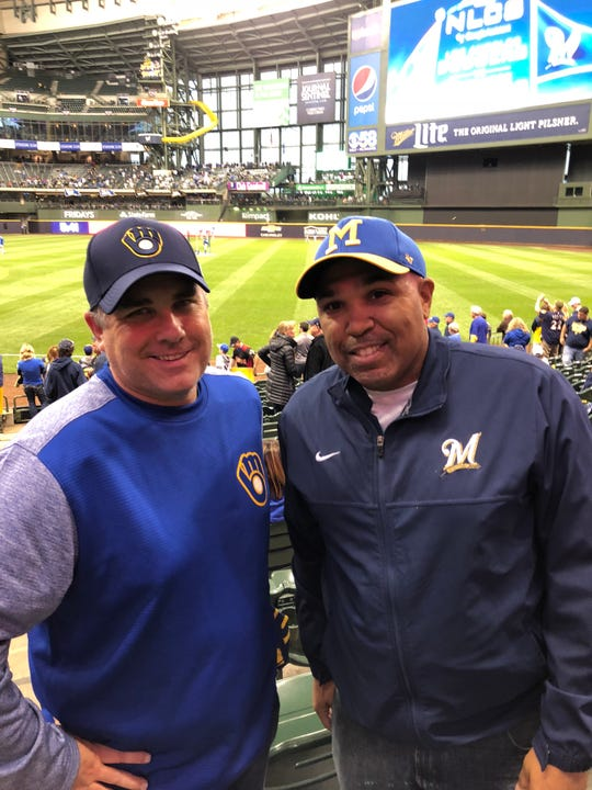 James Flegel (right) used to run errands for neighbors to get enough spending money to come to County Stadium. He's been cheering on the Brewers ever since. He came with a friend, Greg Lecher.