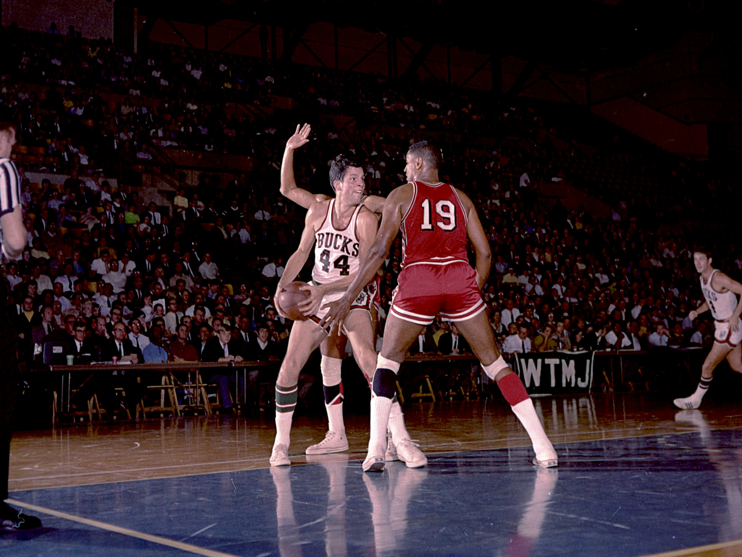 Milwaukee Bucks forward Fred Hetzel (44) finds himself surrounded by Chicago Bulls, including forward Bob Boozer (19) during the Bucks' first-ever game in the NBA on Oct. 16, 1968, at the Milwaukee Arena. The Bucks lost, 89-84.