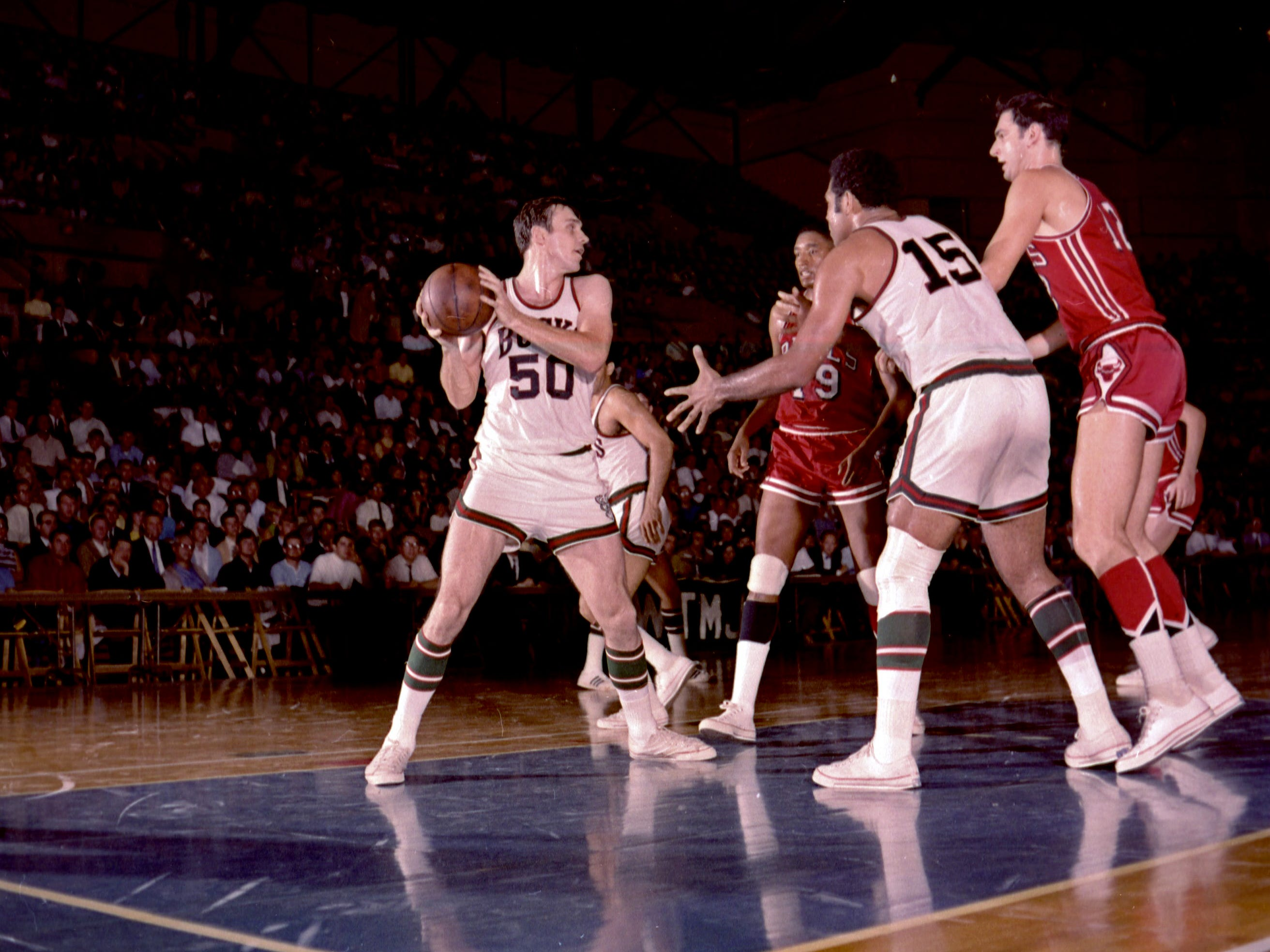 The Bucks' Len Chappell (50) comes up with a rebound during Milwaukee's first regular-season game in the NBA on Oct. 16, 1968, against the Chicago Bulls at the Milwaukee Arena.