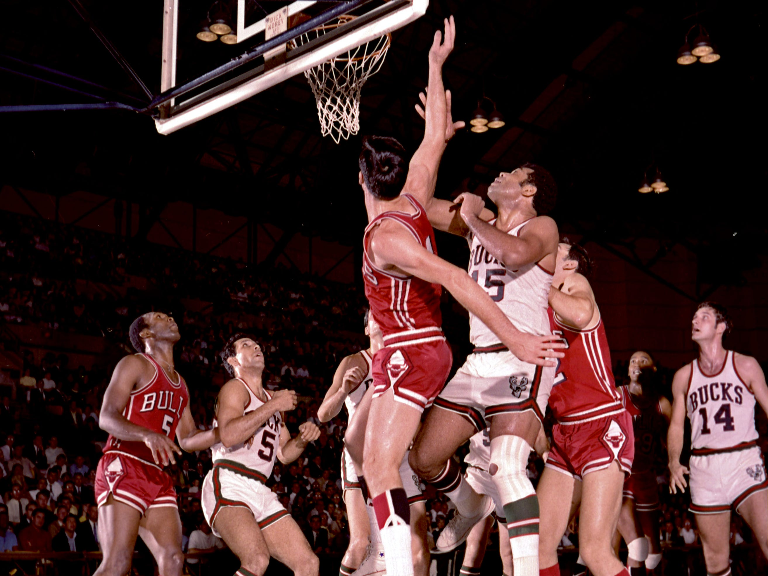 The lane gets pretty crowded during the first-ever Milwaukee Bucks' regular season game against the Chicago Bulls at the Milwaukee Arena on Oct. 16, 1968. Among the players in the mix are the Bulls' Flynn Robinson (5), Bucks' Guy Rodgers (5), Bucks center Wayne Embry (15) and Bucks guard Jon McGlocklin (14).