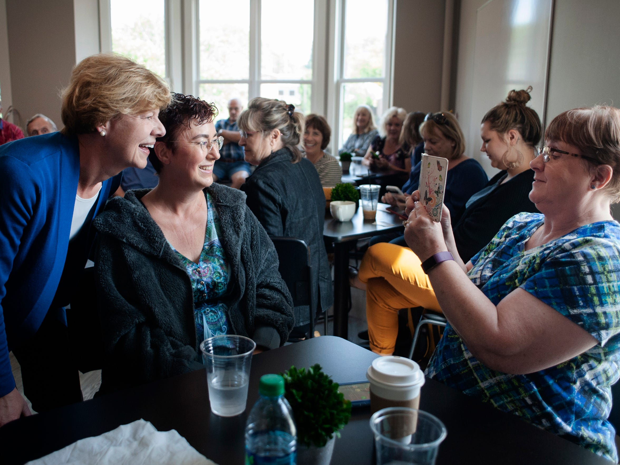 U.S. Sen. Tammy Baldwin (left) poses for a photo with Janesville resident Alicia Jenski during a campaign event  Sept. 20 at Bodacious Brew in downtown Janesville.