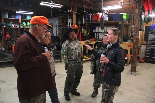 Kari Buckvold, far right, tells the story of her first deer hunt to mentors and participants of a Learn To Hunt program.