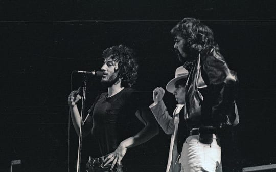"""Bruce Springsteen, left with Steven Van Zandt, center, and Milwaukee DJ Bob Reitman at the Uptown Theater concert  on Oct. 2, 1975 in Milwaukee. The concert is famous in Milwaukee and among E Street Band fans, known as the """"bomb scare show."""""""