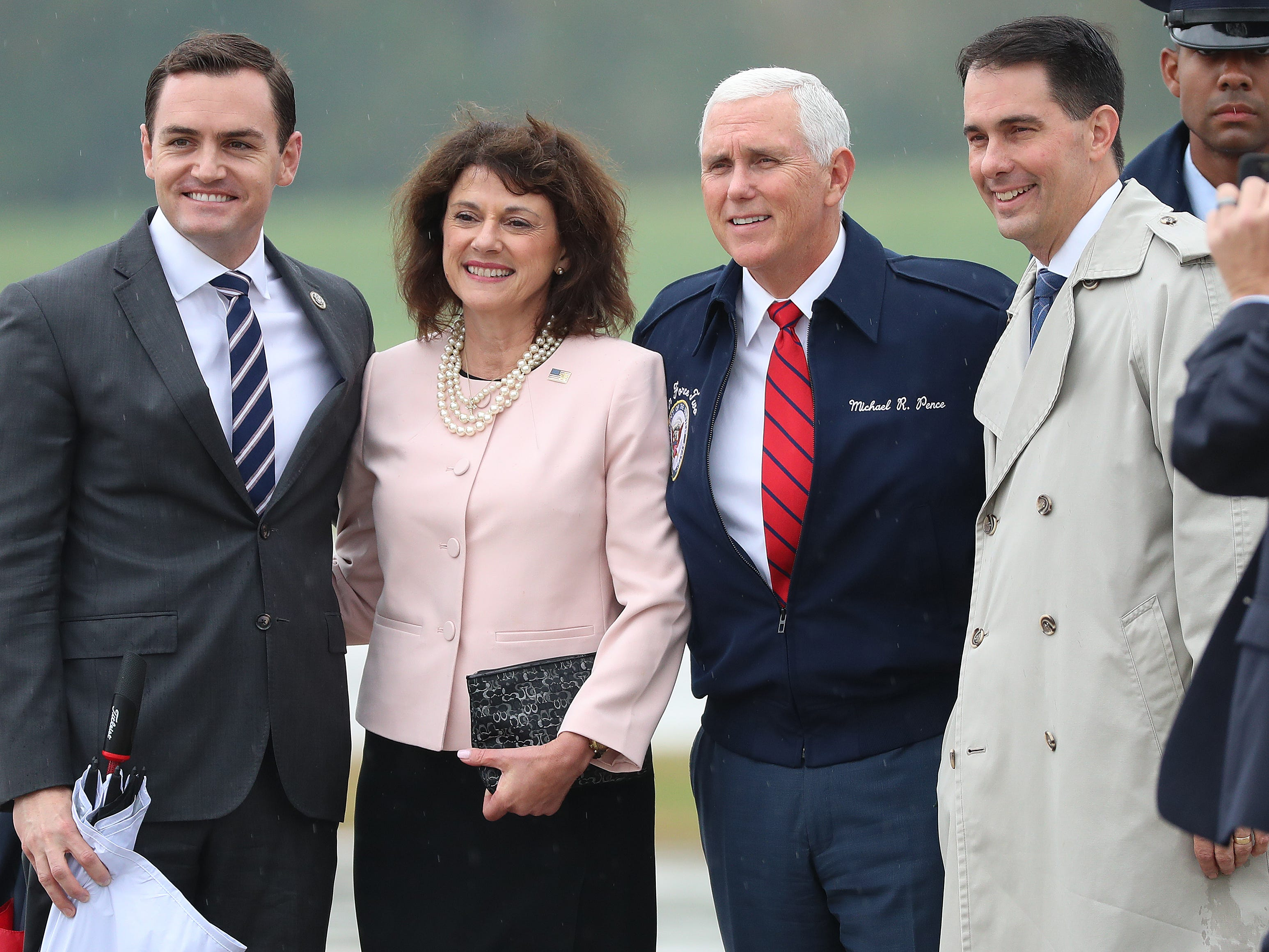 Vice President Mike Pence poses for a photo at Green Bay Austin Straubel International Airport with U.S. Rep. Mike Gallagher (left), Senate candidate Leah Vukmir and Gov. Scott Walker on Oct.  10.