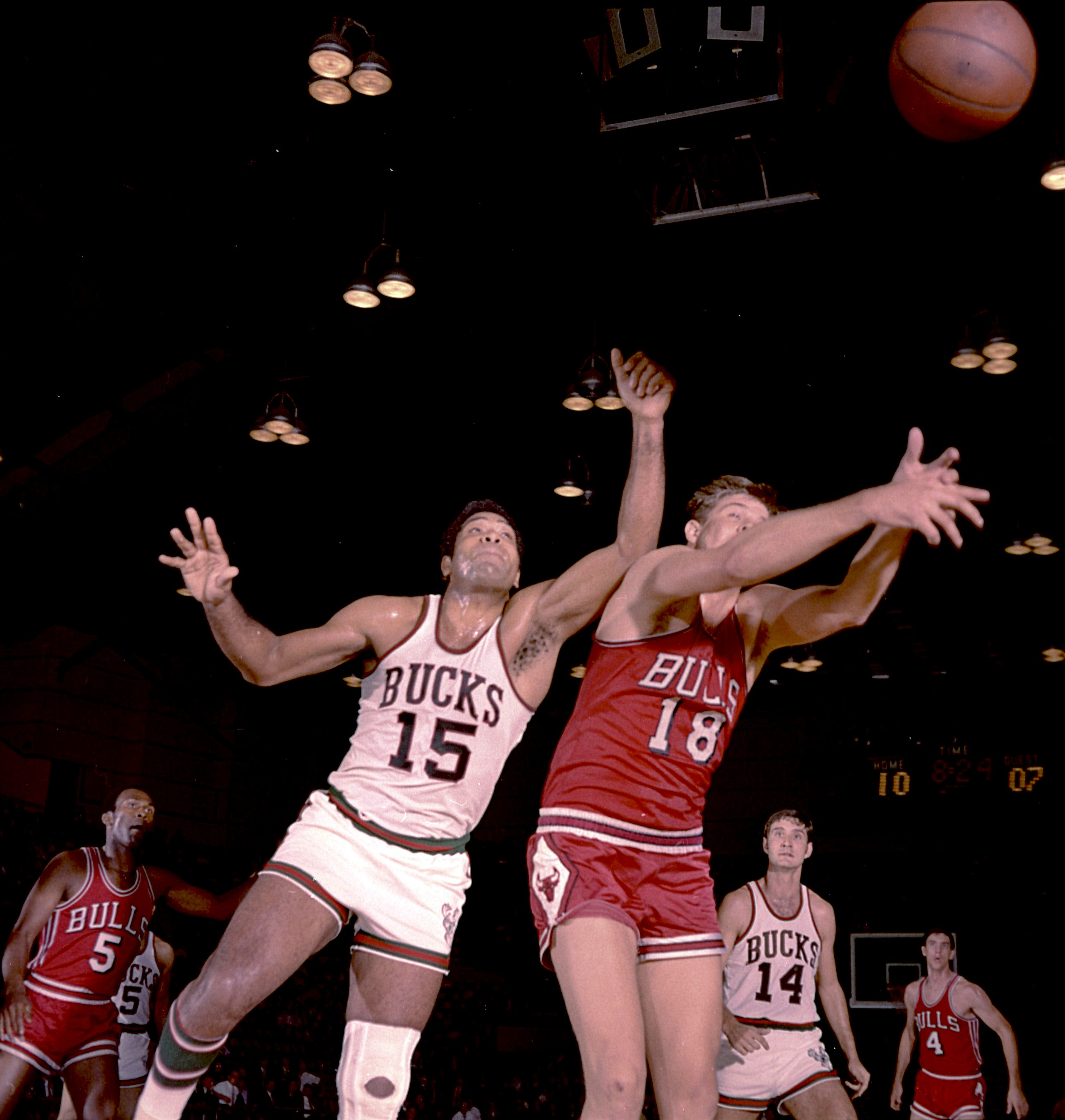 Battle of the big men: Milwaukee Bucks center Wayne Embry (15) and Chicago Bulls center Tom Boerwinkle (18) get up close and personal during the Bucks' first-ever game in the NBA on Oct. 16, 1968, at the Milwaukee Arena. Looking on are Bulls guards Flynn Robinson (5) and Jerry Sloan (4) and Bucks guard Jon McGlocklin (14). The Bucks lost, 89-84, in front of a crowd of 8,467 people.