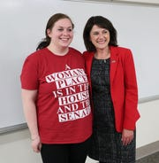 Republican U.S. Senate candidate Leah Vukmir poses with Samantha Firari (left), a junior nursing student at UW-Milwaukee on Oct. 1.