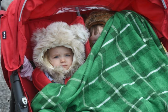 Many people bundled up Friday as they braved cooler temperatures and light rain to attend the 73rd Annual Turkey Trot Festival.