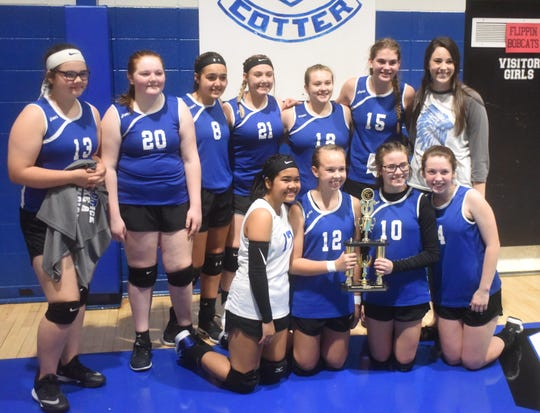 The Cotter Junior Lady Warriors pose with the 2A-North District runner-up trophy on Thursday night.