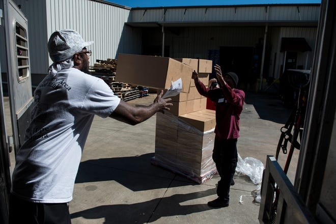 Packaged meals are loaded up at Montgomery Area Food Bank in Montgomery, Ala., on Friday, Oct. 12, 2018. The food is headed to Mexico Beach, Fla. to help those affected by Hurricane Michael.
