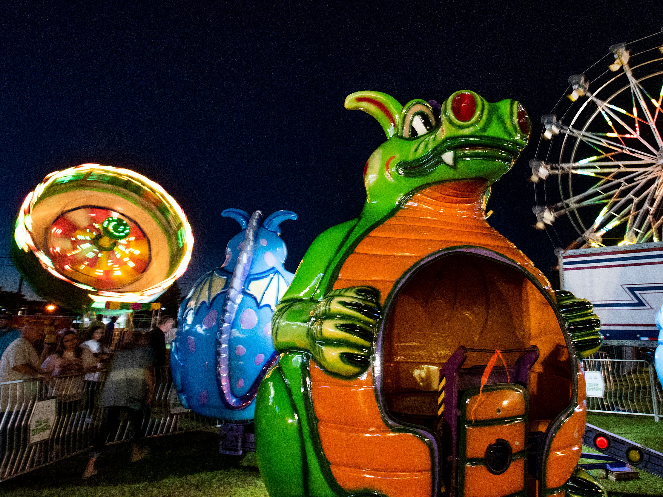 Families enjoy the Autauga County Fair in Prattville, Ala., on Thursday evening October 11, 2018. The fair runs through Saturday the 13th.