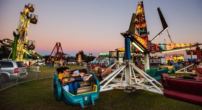 Families enjoy the Autauga County Fair in Prattville, Ala., on Thursday evening October 11, 2018.