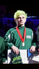 New Castle's A.J. Black stands on the podium after his runner-up finish at the state finals last season.