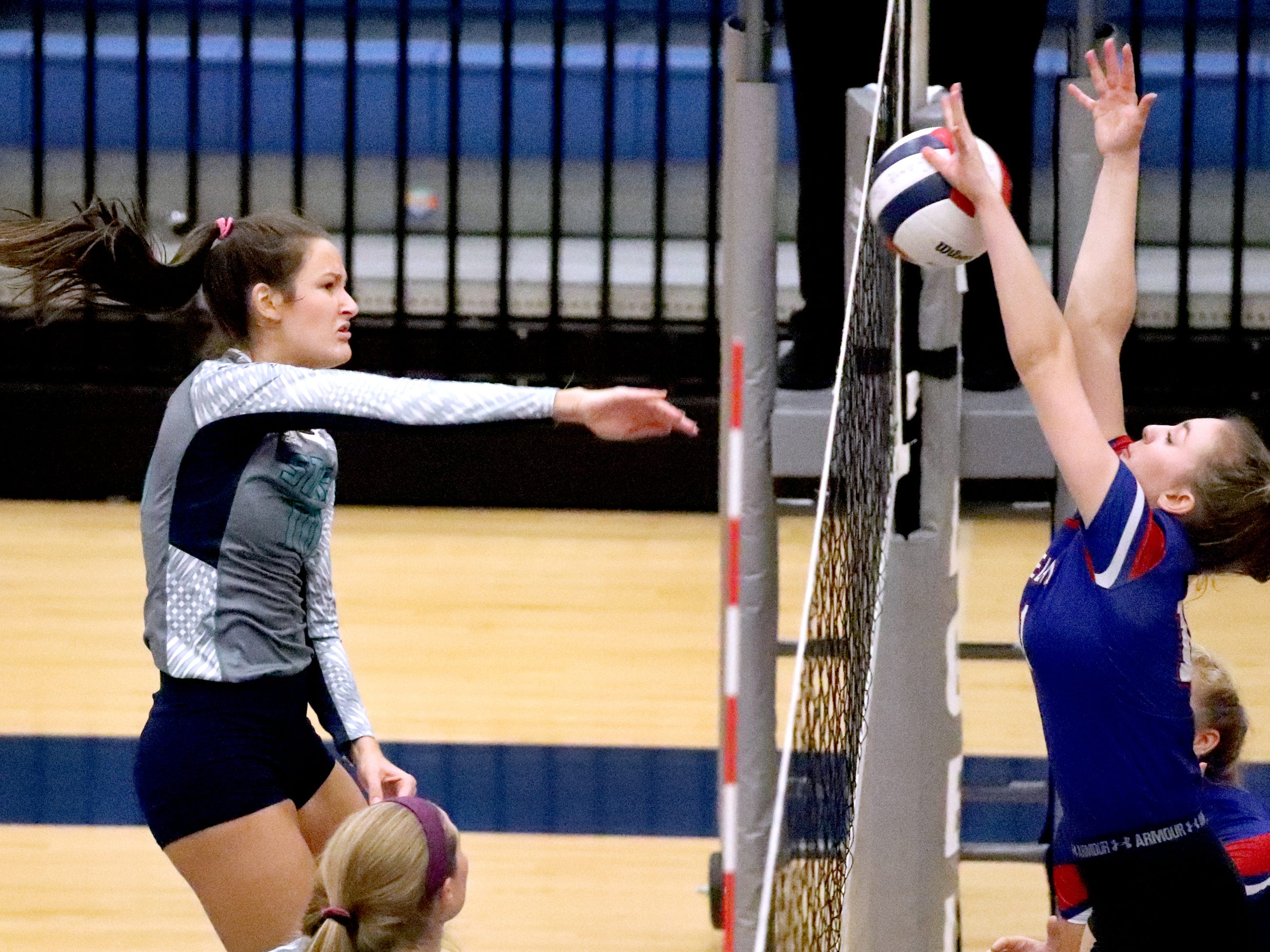 Siegel's Grace Reidmiller (10) hits the ball over the net during the Class AAA sectional against Cleveland Thursday, Oct. 11, 2018. Siegel beat Cleveland to advance to the State Championship tournament.