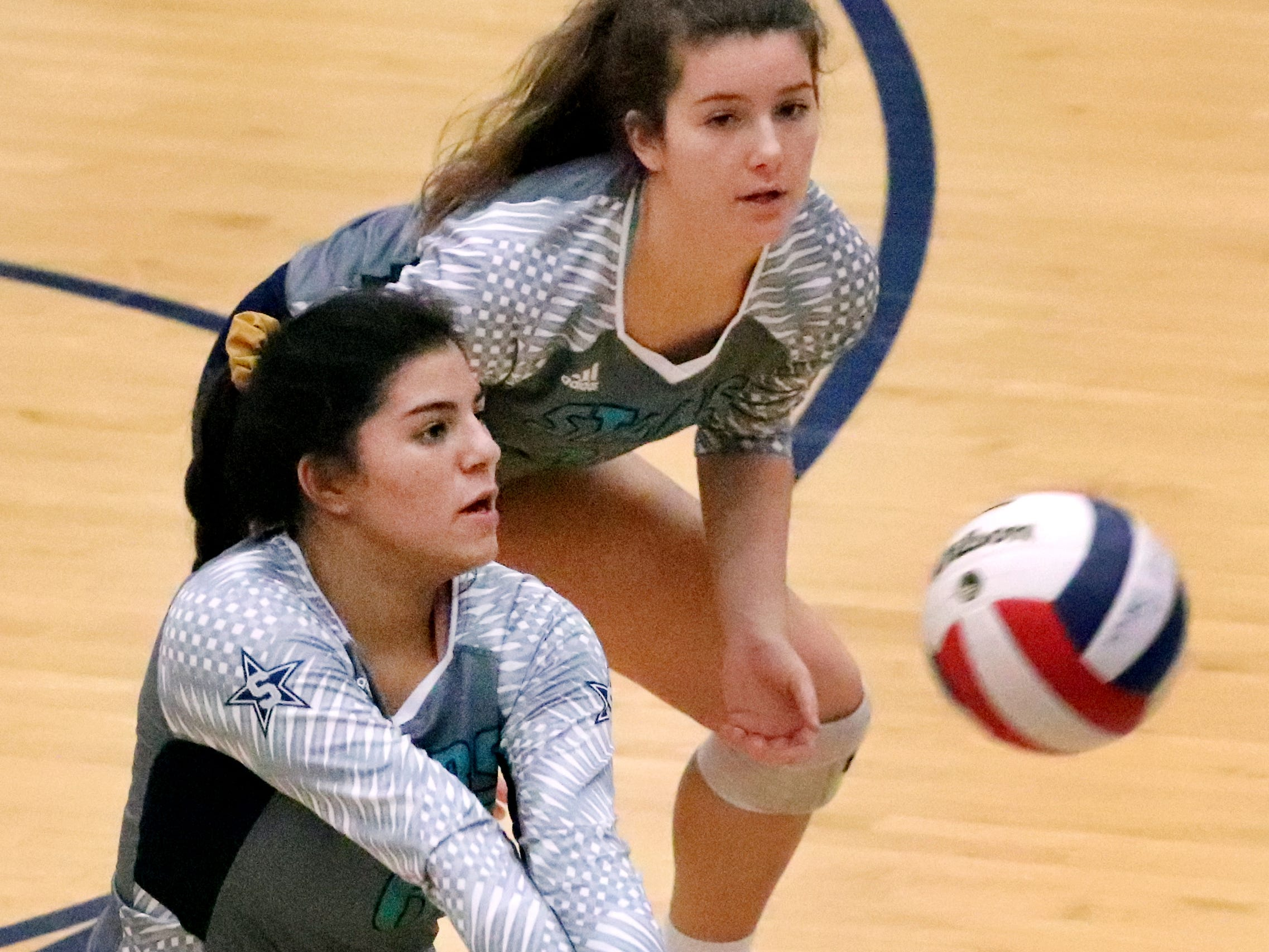 Siegel's June Padilla (6) bumps the ball as Zoe Delk (20) watches in the background during the Class AAA sectional against Cleveland Thursday, Oct. 11, 2018. Siegel beat Cleveland to advance to the State Championship tournament.