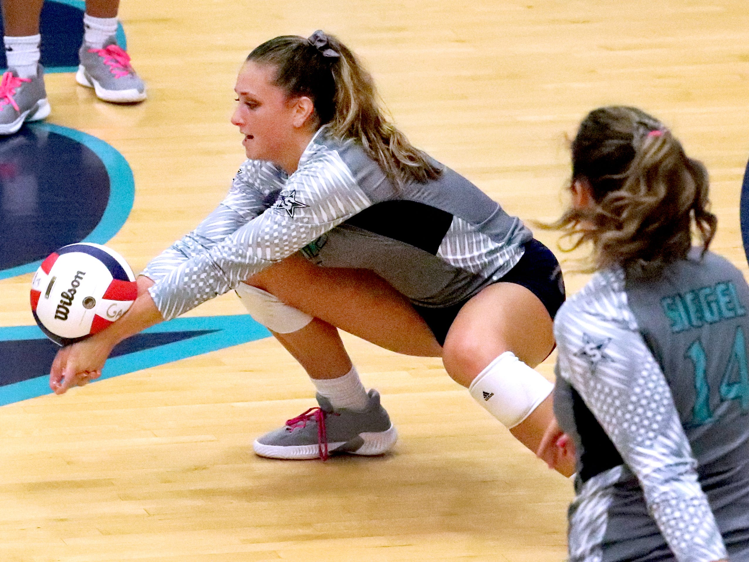 Siegel's Julia Wheeler (5) digs he ball during the Class AAA sectional against Cleveland Thursday, Oct. 11, 2018. Siegel beat Cleveland to advance to the State Championship tournament.